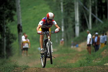 Well known racer, Greg Herbold, races in the 1990 World Mountain Bicycle Championships held in Durango, Colorado. Durango was and has been a Mecca for Mountain bikers throughout the nation. The 1990 championships were the first ever unified world championships.