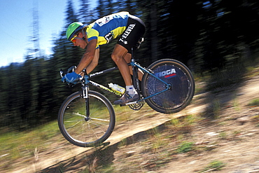 Well known racer, John Tomac, races in the 1990 World Mountain Bicycle Championships held in Durango, Colorado. Durango was and has been a Mecca for Mountain bikers throughout the nation. The 1990 championships were the first ever unified world championships.