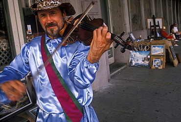 A musician performs during Mardi Gras celebrations in Galveston, Texas