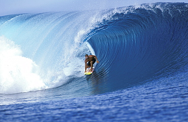 Surfer Pancho Sullivan in the tube at Teahupoo, on the island of Tahiti in French Polynesia.