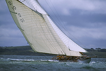 A beautiful classic yacht, an 85' gaff rigged sloop races in the America's Cup, where the dark skies of Cowes, England predict stormy seas.