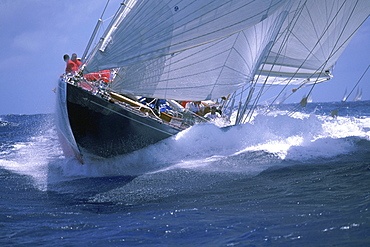 """America's Cup J Class yacht """"Endeavour"""" sails under spinnaker in the Antigua Classic Yacht Regatta."""