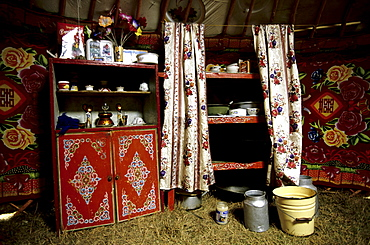 Interior of a ger. The internal layout of a ger is universal throughout Mongolia. Near the door, on the female side (right), are the cooking implements and water buckets. Tavanbogd National Park, Mongolia.