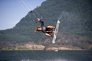 Sky Solbach rips an indie grab while kiteboarding on the Columbia River near Stevenson WA