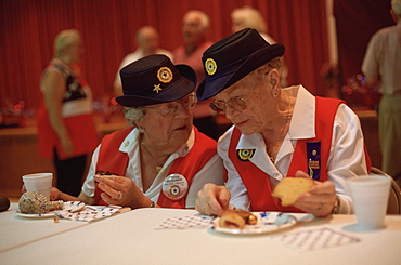 Seniors share a bit of gossip after an American Legion Auxillary meeting in Nalcrest, Forida a planned retirement community for US Postal workers.