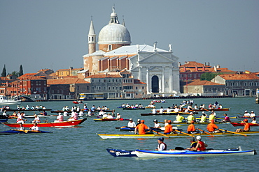 Participants of Vogalonga, a 32 km jaunt from the Bacino de San Marco up to Burano and back down to the Grand Canal via Cannaregio, on boats of all descriptions (powered by human muscle), on canal San Marco, in Venice, Italy on June 15, 2004.