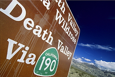 A Road sign on CA 178 between Trona and Death Valley National Park with snow covered Telescope Peak (11049 ft, 3369 m) in the background in Panamint Valley, California on february 15, 2004. Although Death Valley is considered the hottest place on earth some summits in the park receive few feet of snow every winter.