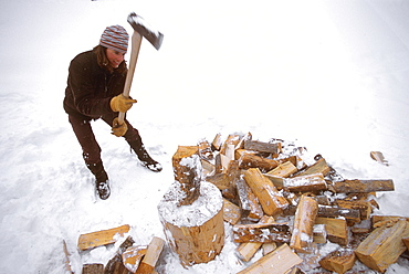 Kit Deslauriers splits logs for firewood in Jackson Hole, Wyoming.