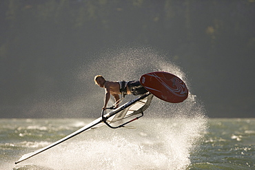 """Rob Warwick lets it all hang out, performing a """"Shove It"""" at The Hatchery, Hood River, Oregon"""