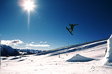 Big air in the snowboard park, out of control.