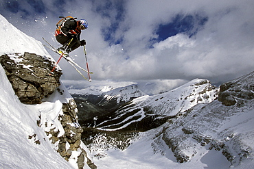 Sven Brunso catches air while skiing Delirium Dive at Sunshine Village Ski Resort in Banff National Park, Alberta, Canada.