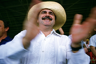 A man claps during a rally for Huber Matos in Miami, Florida. (motion blur)