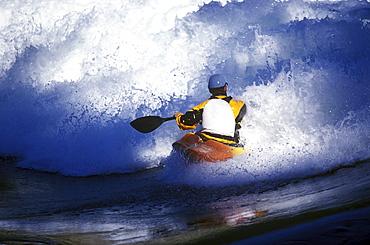 Jack Kennedy kayaking at the Skookumchuck wave in British Colombia, Canada