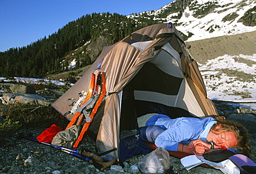 Senja Palonen sleeps in her tent after setting up camp below Ossa Mountain in the Tantalus Range, British Columbia
