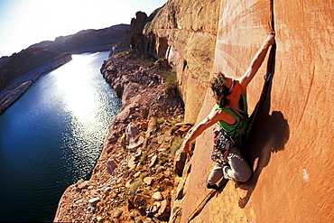 Todd Snyder lead climbing on a first ascent in Lake Powell, Utah