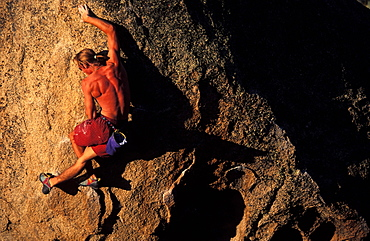 Dwight Duke about to step up on a bouldering problem in the Buttermilks near Bishop, California.