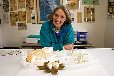 Judy Schad of Capriole, Inc, one of America's top cheesemakers, located in Greenville, Indiana poses with some of her goat cheeses