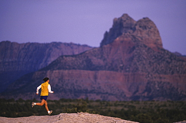 Talyn Villasenor runs on slickrock at Gooseberry Mesa in Southern Utah.