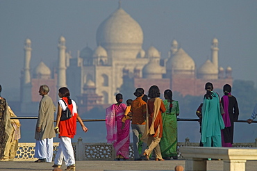 The Taj Mahal rises out of the plains of Uttar Pradesh as viewed from Agra's Red Fort. The Taj Mahal, one of the Seven Wonders of the World, was built by Moghul Emperor Shah Jahan between 1621-1623 and required the labor of thousands of artisans.