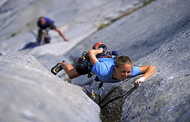 Tommy Caldwell belays female rock climber Beth Rodden as she climbs a crack on the West Buttress climbing route on El Capitan in Yosemite National Park, California. Beth Rodden and Tommy Caldwelll are two of the world's leading big wall climbers.