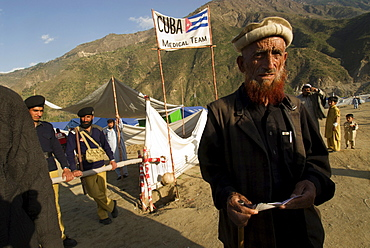A Pashtun man stands outside the Cuban hospital in the Meira camp for earthquake survivors, NWFP, Pakistan.  The Cuban government sent 30,000 doctors, nurses and other personnel to set up field hospitals throughout the earthquake affected area.  The Meira Tent camp (also called Mera, or Maria camp), is run by the Pakistani army like a small city, and  is located on the Indus River in the Battagram district.  The camp, the largest for displaced people in Pakistan, hosts over 21,000 earthquake survivors, primarily Pashtuns from the Allai valley in Pakistan's NWFP, one of the areas worst-hit by the October 8, 2005 earthquake.