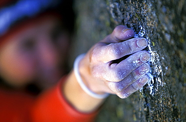 Rock climber Beth Rodden crimping a hold with chalky hands on Renaissance Wall at the Lumpy Ridge climbing area in Rocky Mountain National Park outside of Fort Collins, Colorado. Beth Rodden is one of the world's leading free climbers.