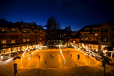 Nighttime at the ice rink in Heavenly Village at the base of Heavenly Mountain Resort, South Lake Tahoe, CA.