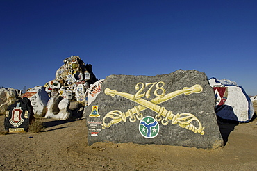 At the main gate to Fort Irwin, departing units, having completed the  14-day desert training exercise, leave their marks on a designated pile of rocks.