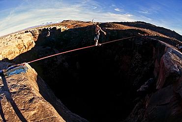 Dean Potter slacklining near Moab, Utah.