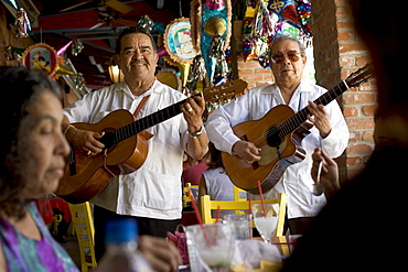 Two mariachis performing for customers at a restaurant in San Antonio, Texas.