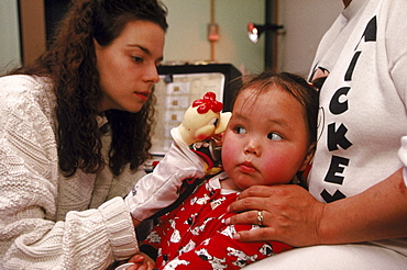 """Hearing tests with 2 year old Angie. Hearing problems are found in about 25% of Inuit kids. Angie is suffering from an infection called """"otitis media""""."""