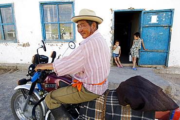 Mongolian nomad on motocycle