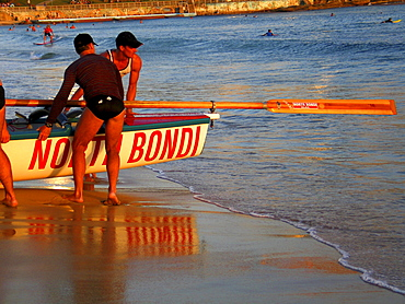 A group of people preparing a surf boat in Sydney, Australia.
