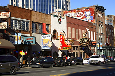 Lower Broadway in Nashville, TN with its mix of touristy country music related attractions juxtaposed with a booming commercial
