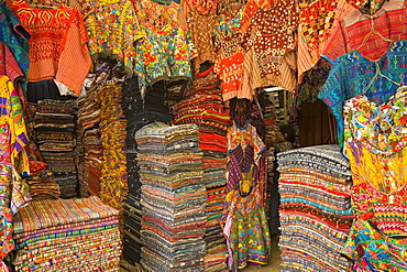 Authentic and colorful textiles in shopping both, Antigua, Guatemala