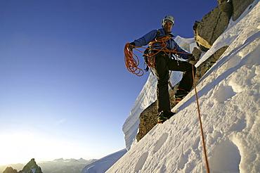 A man ascending a mountain.