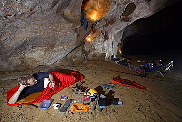 One cave explorer delays the dreaded task of getting up from his sleeping bag and put on his cold wet clothes again from the day