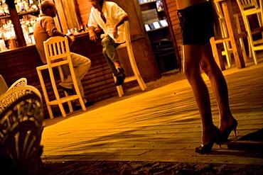 A woman's high heeled legs in a beach bar in the Dominican Republic