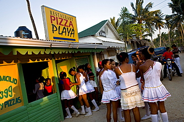 A high school drill team during an outing for pizza in the Dominican Republic