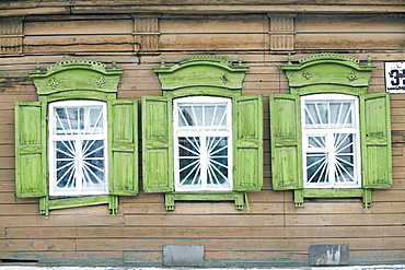 A set of windows from a traditional wooden home in Irkutsk, Siberia, Russia.