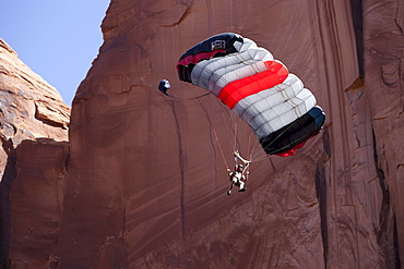 Andy Lewis base jumping off the Tombstone, Moab Utah