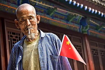 Old local Smoking a cigar, Xian, Shaanxi Province, China