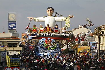 Mario Draghi is an Italian banker and economist. A float representing the European financial crisis as the Titanic in the streets of the city of Viareggio during the Color parade -- The masks and the floats of the Color Parade during the carnival of Viareggio. - 857-48848