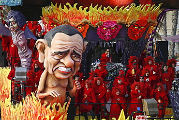 A float representing the Italian businessman and politician Silvio Berlusconi surrounded by masks during the Carnival of Viareggio.