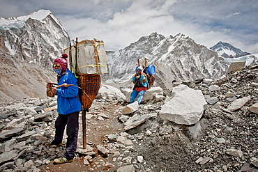 Two porters rest while delivering supplies to Everest Base Camp