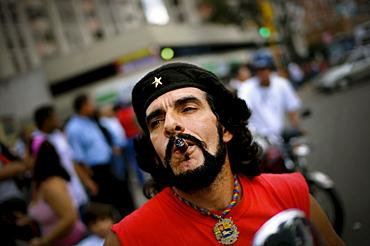 Che Guevara impersonator smokes a cigar in Venezuela.