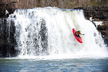 A professional kayaker runs falls in Tennessee.