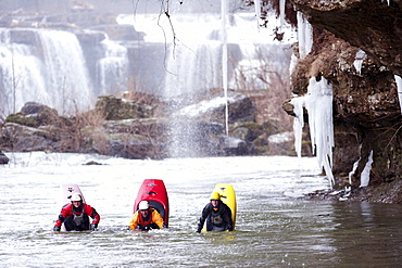 Three kayakers in a bow stall in Tennessee.