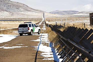 The border crossing at Columbus, NM, has Normandy-style fencing running east.