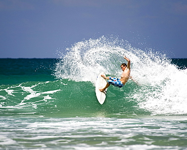 Surfing in Hanalei Bay on Kauai's north shore, Hawaii.